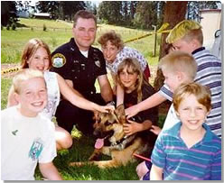 K9 Officer Miller with K9 Arco and children